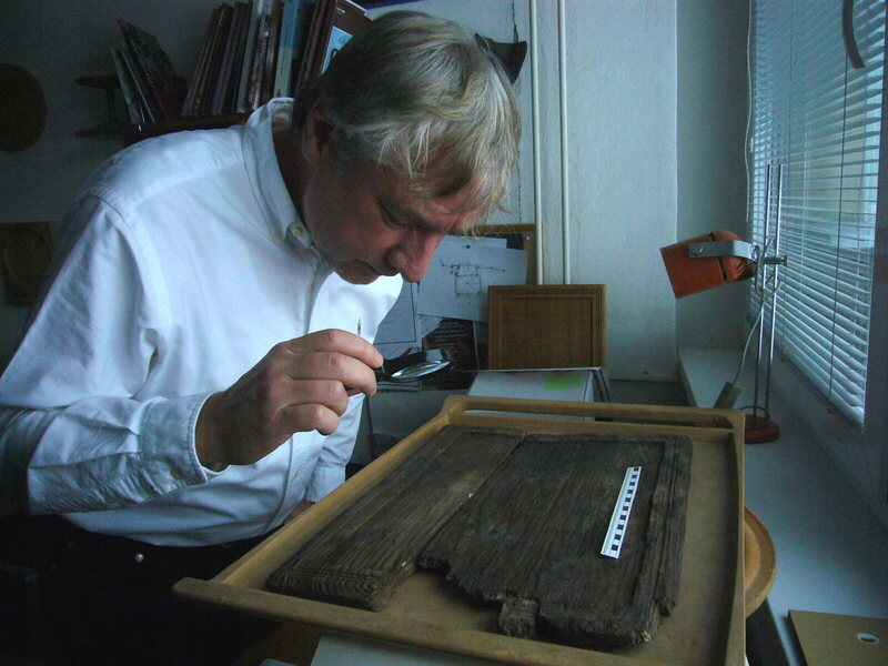 Ulrich Schädler examines the game board found in Poprad, Slovakia.