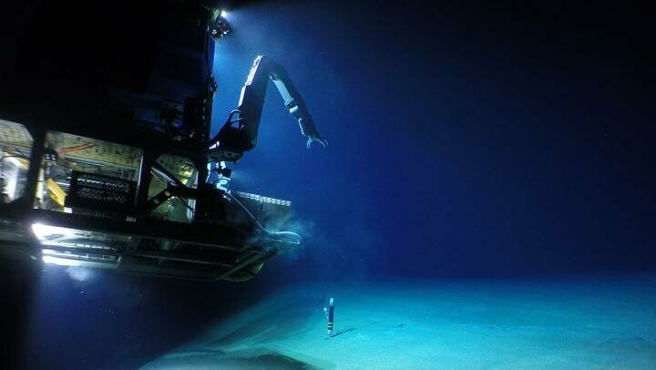 A remotely operated robot touches down on the seafloor to explore Havre.