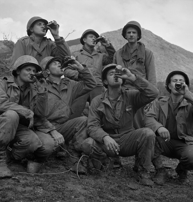 Coca-Cola worked with the U.S. government to ensure troops, including these men in Italy, had access to Coke throughout World War II.