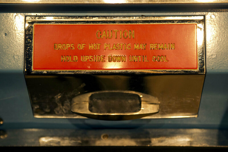 The Mold-A-Rama heats plastic pellets to 250 degrees and includes a warning that the figurine will come out warm and possibly dripping.