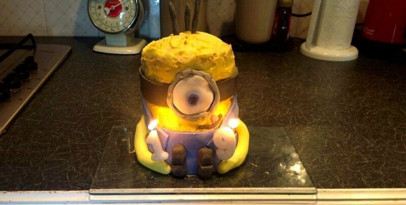 The height of the minion craze immortalized in birthday cake form. Note the long, long arms.