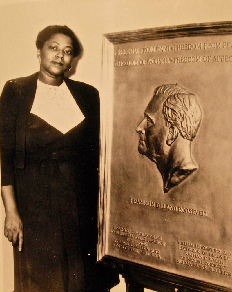 Selma Burke poses with her bronze plaque of President Roosevelt, which was unveiled shortly after his death in 1945.