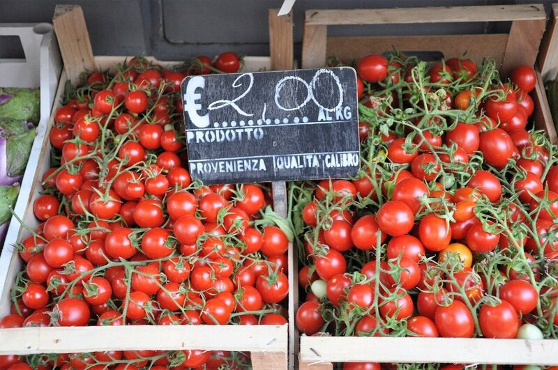 Tomatoes for sale at a market stall in Italy.