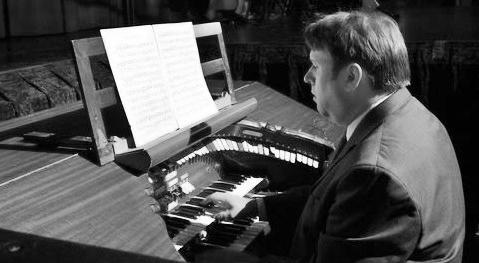 Bernie Anderson at an organ.