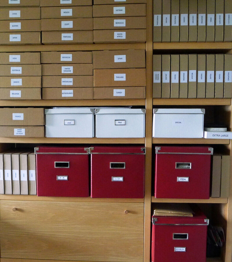 Flores' collection is neatly kept and filed by country.
