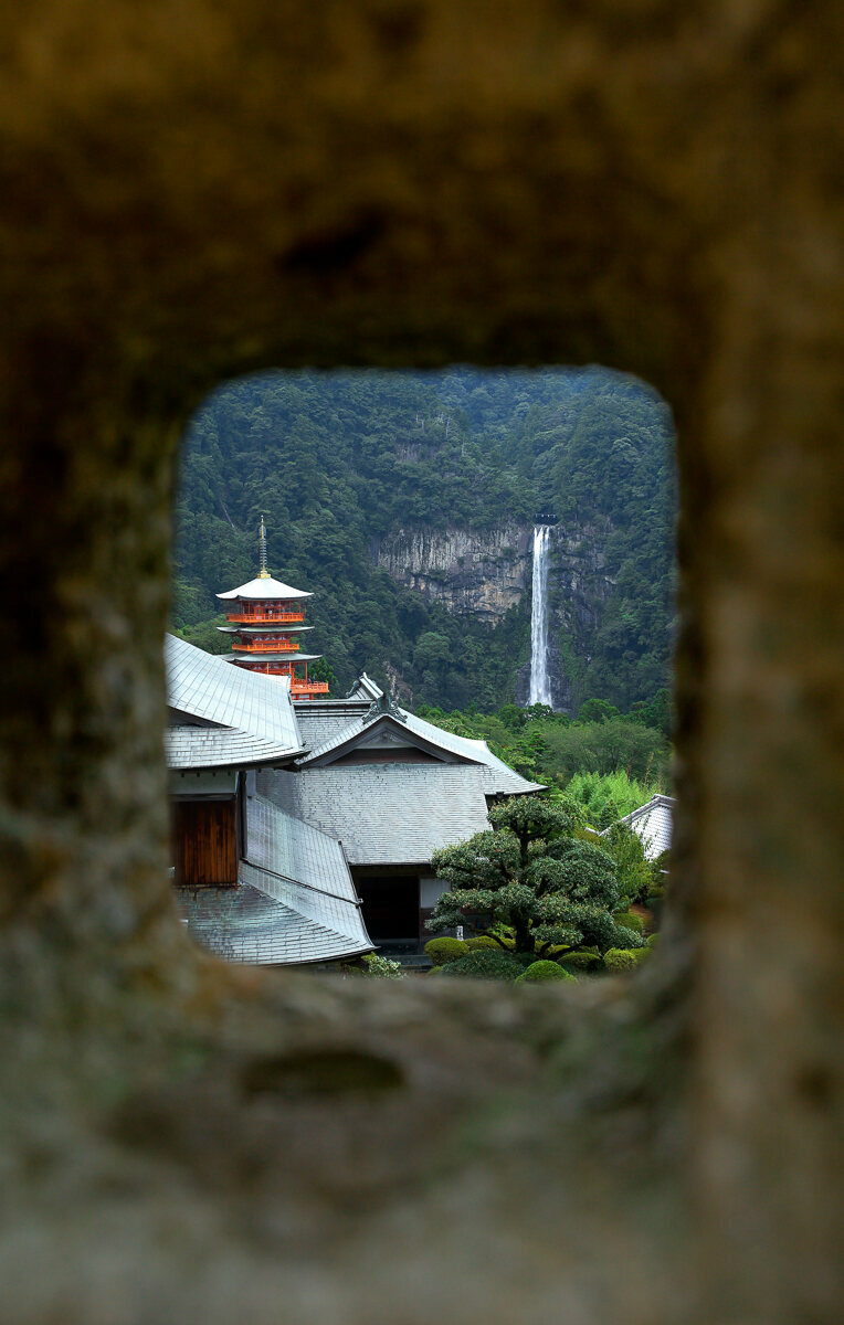 A view of the waterfall and pagoda through the hole from one of the many Kasuka-doro pedestal lanterns that are sprinkled throughout the site.