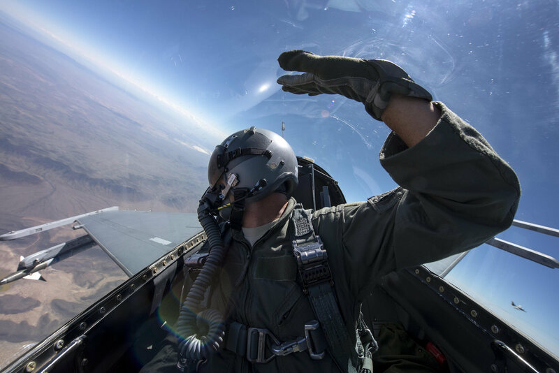 A pilot in the harness of an F-16.