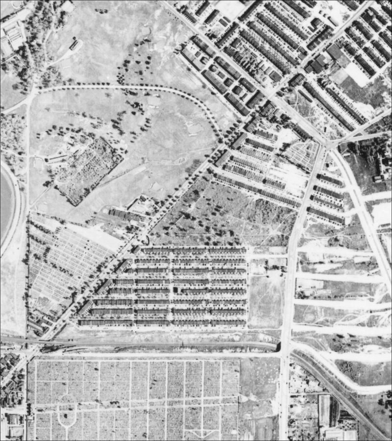 A 1938 aerial view of the cemetery, the plot at center surrounded by houses.
