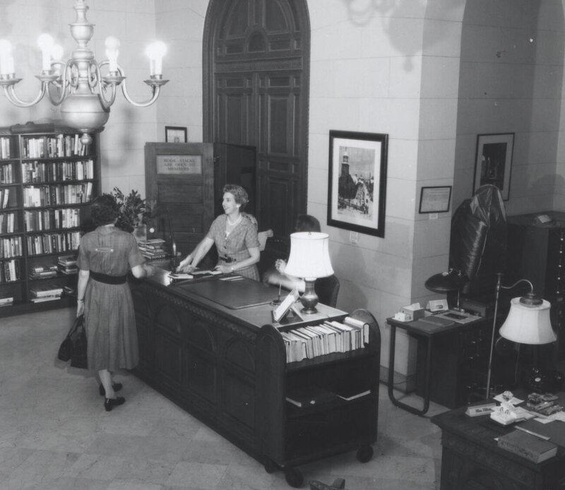 Librarian Sylvia Hilton at the Circulation Desk, c. 1953.