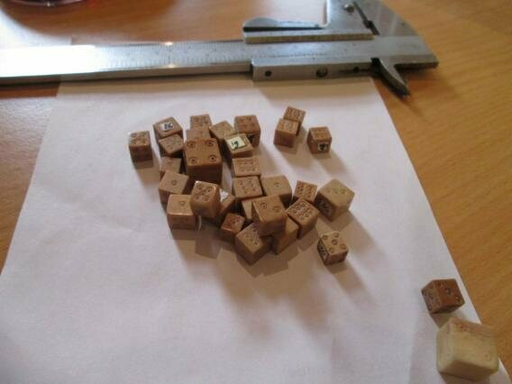 These 14th-century medieval dice were discovered during an excavation in the 1990s.