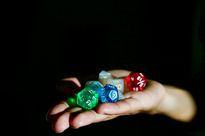 Someone about to roll some dice.