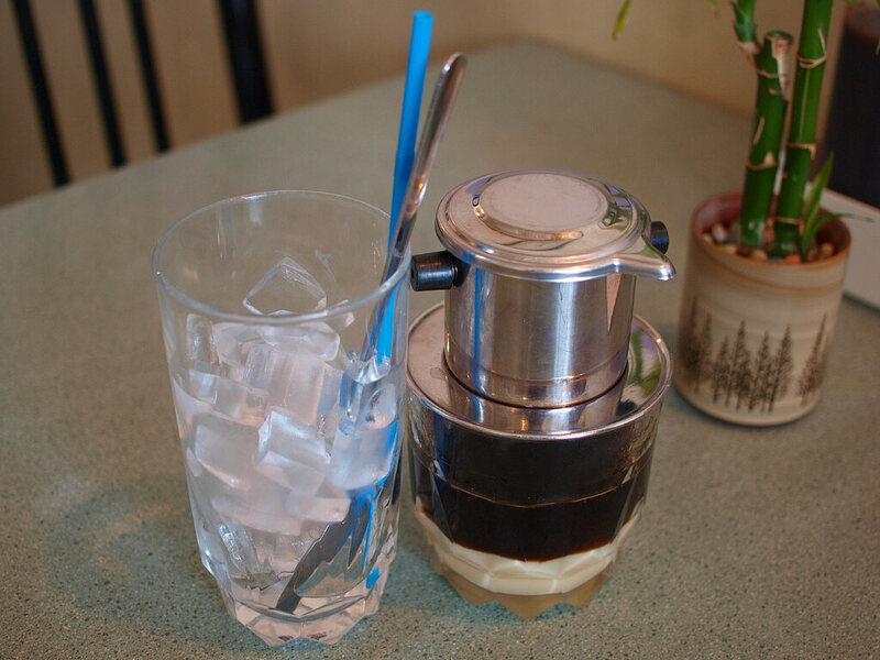 A cà phê sữa đá, complete with <em>phin</em> filter.