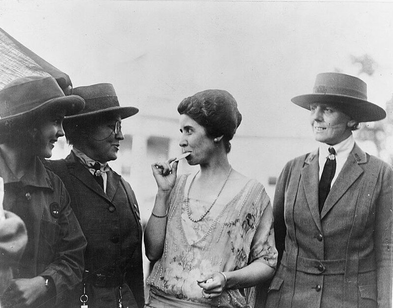 First Lady Grace Coolidge, eating a Girl Scout cookie in 1923.