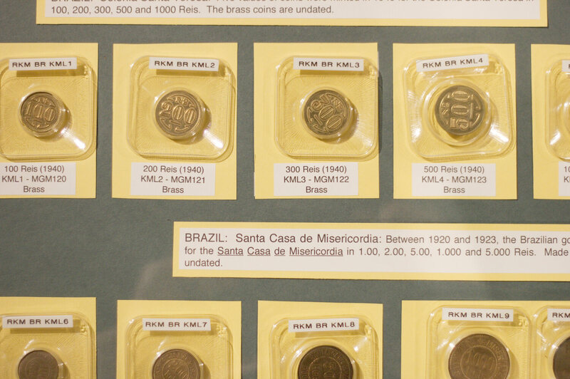 Coins on display at the National Hansen's Disease Museum.
