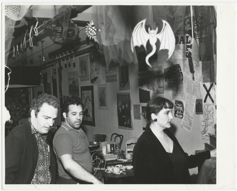 Joe Cino, middle, in the re-opened Caffe Cino, some months after a 1965 fire.