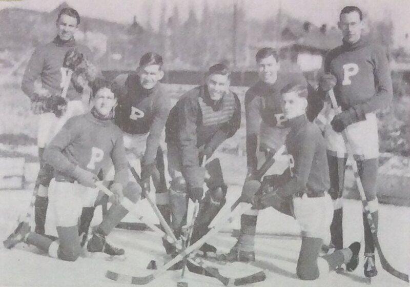 The 1934 Pyongyang Foreign School hockey team. Goaltender Samuel Moffett is at center.