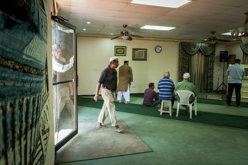 Men filter into the mosque in San Pedro Sula for Friday prayers, which are led in Arabic and Spanish.