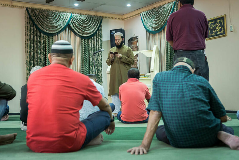Imam Mohammed leads Friday prayers at the mosque in San Pedro Sula.