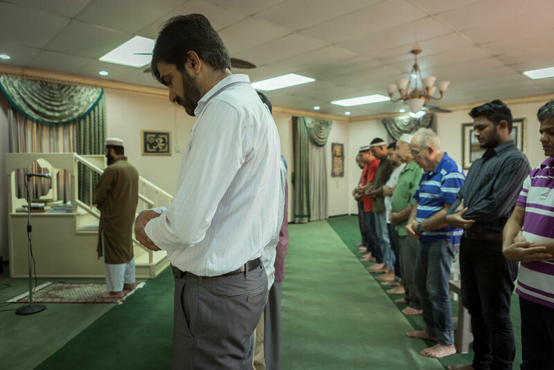 The prayers are spoken in a mix of Arabic and Spanish to serve the mosque's diverse population of worshippers.