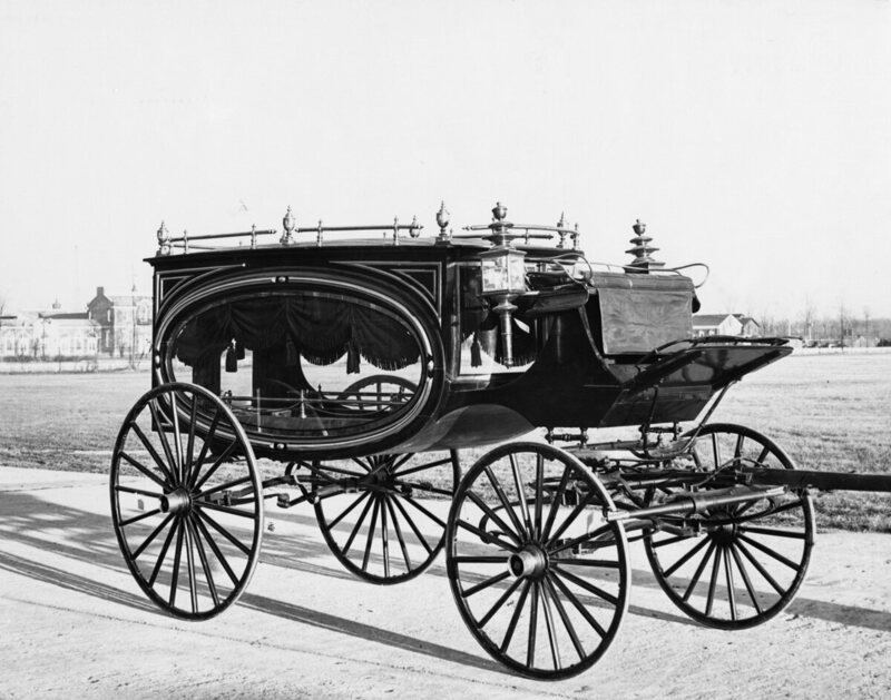 A horse-drawn hearse from the 1870s speaks to the evolving rituals around death in America.