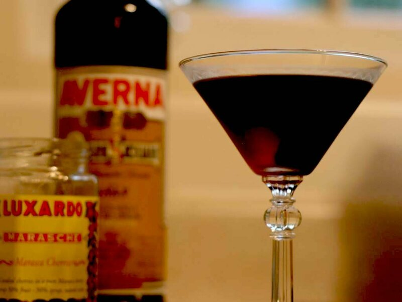 A Luxardo cherry is the centerpiece of this cocktail, known as a Black Manhattan.