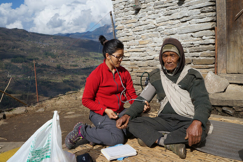 Dr. Sobi Maya Tamang with a patient in a remote village in the Himalayas.