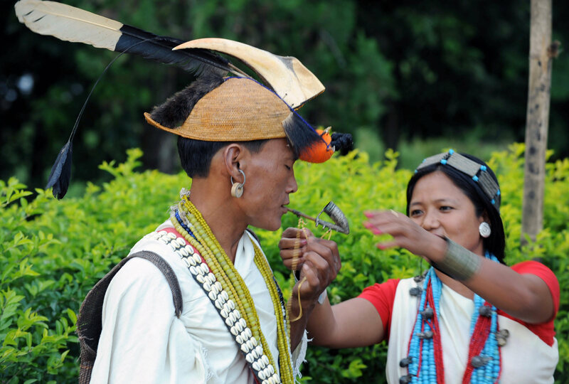 A Nyishi tribesman wearing headgear made out of the beak and feathers of a hornbill at a village in Arunachal Pradesh.