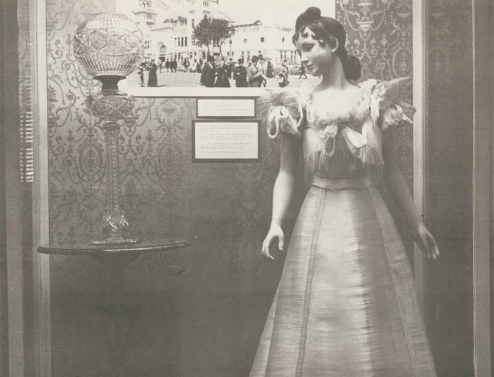 A mannequin models a dress made from spun-glass cloth.