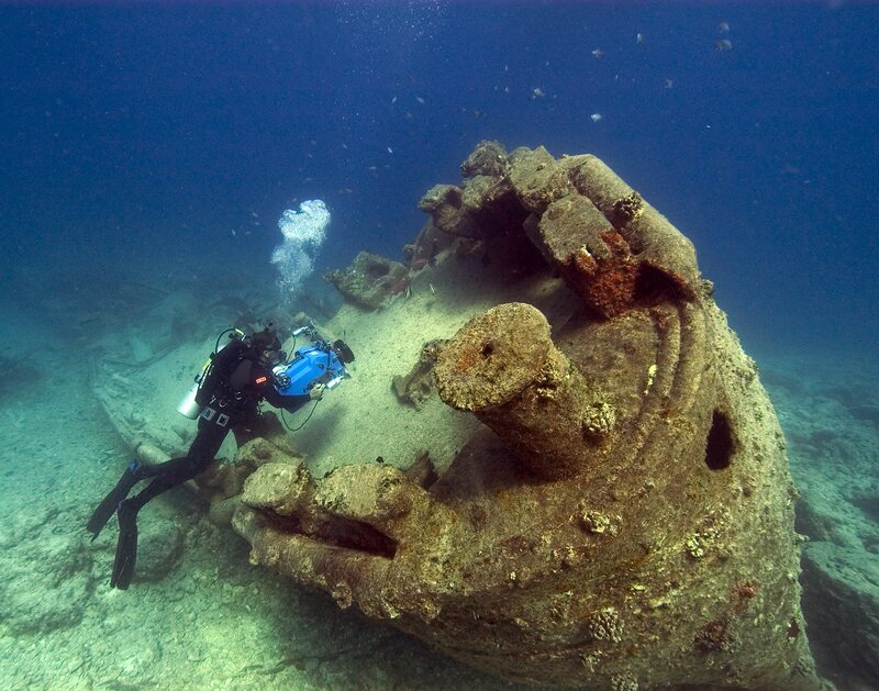 Wrecks stand to see a number of threats in a changing ocean. Here, NOAA diver John Brooks a ship off the coast of Hawaii.