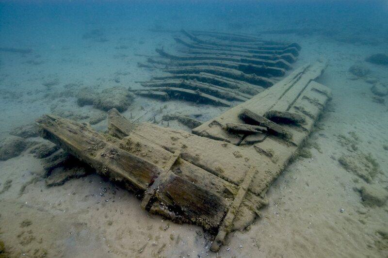 Some wrecks lay flush against the sand.