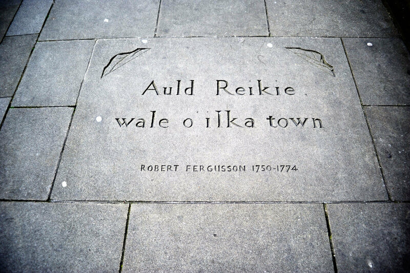 A quote from poet Robert Fergusson engraved into the sidewalk in Edinburgh.