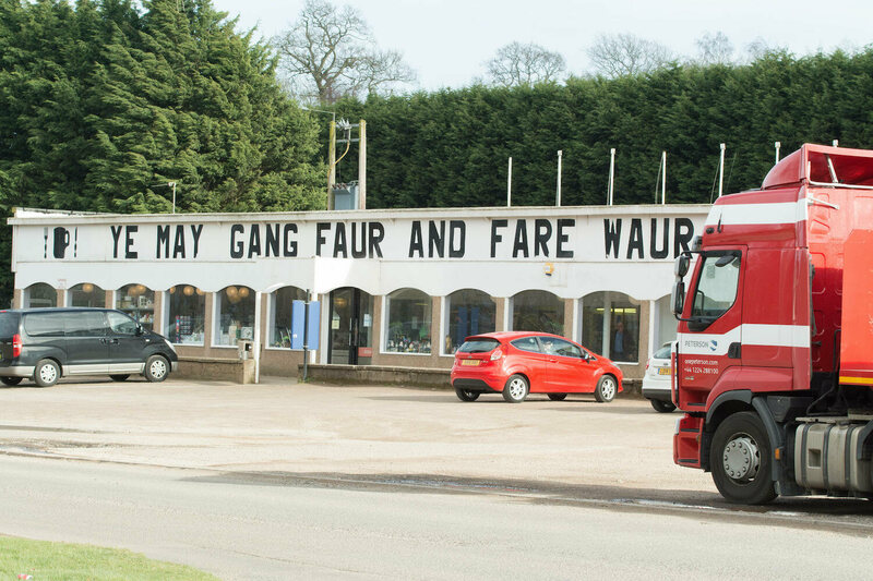 A gas station in Scotland with the Scots phrase 'Ye may gang faur an fare waur' - You may go further and do a lot worse.