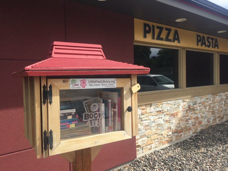 In Montana, this Little Free Library is filled with books and magazines.
