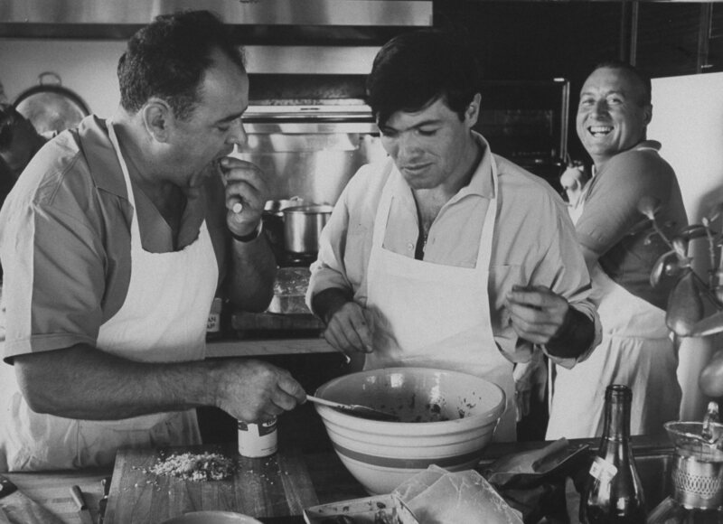 Whilte House Chef René Verdon (left) and former chef Jacques Pepin preparing a salad for a picnic on Gardiners Island.