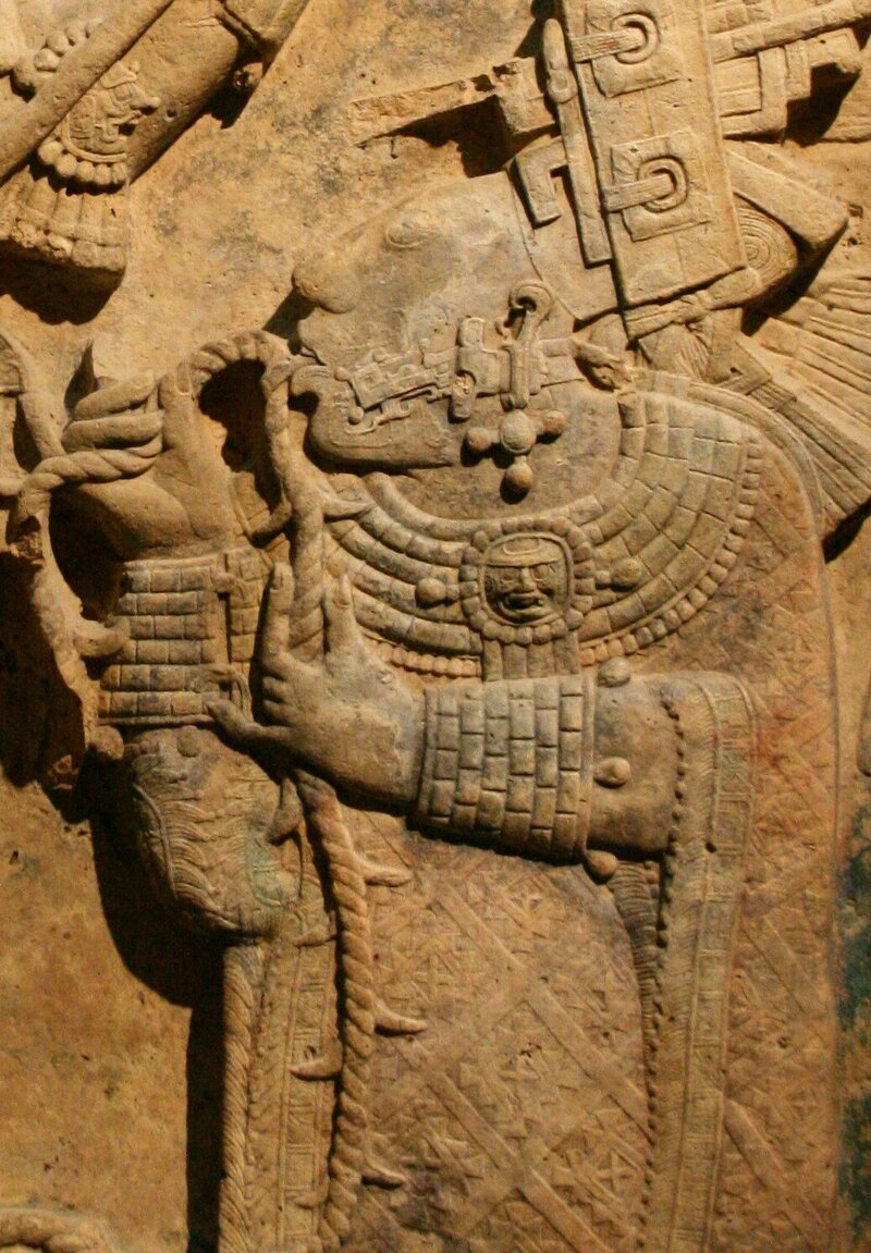 The ancient Maya relief depicting a sacred blood-letting ritual where Queen Lady Xoc draws a barbed rope through her pierced tongue.