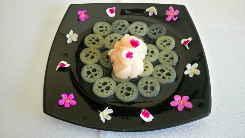 A flower-decked plate of waterlily <em>sunomono.</em>