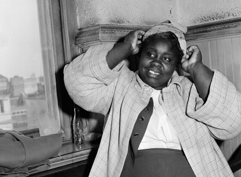 Georgia Gilmore poses for photographers after testifying as a defense witness in the bus boycott trial of Rev. Martin Luther King Jr., March 21, 1956, in Montgomery.