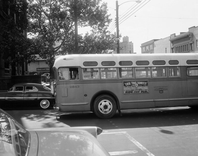 A driver guides an empty bus through downtown Montgomery, Ala., April 26, 1956.