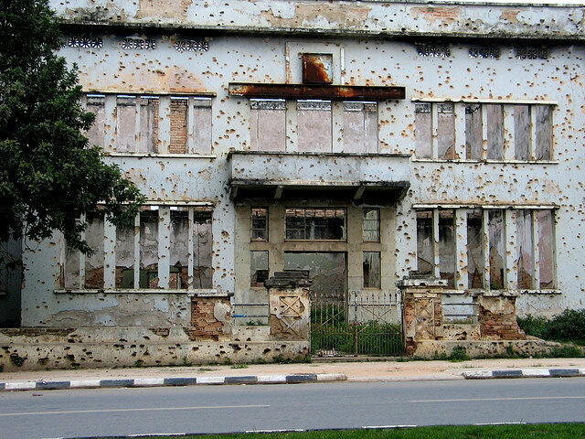 A building  in Huambo covered in bullet holes from the Angolan civil war.
