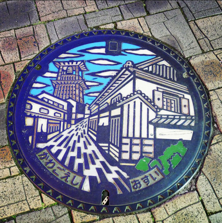 Singer Kei Takebuchi spent hours in Kawagoe City to capture this photograph of a manhole cover depicting a historic bell tower.