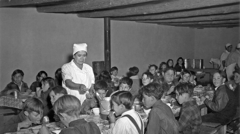 Kids eat WPA school meals during the Depression.