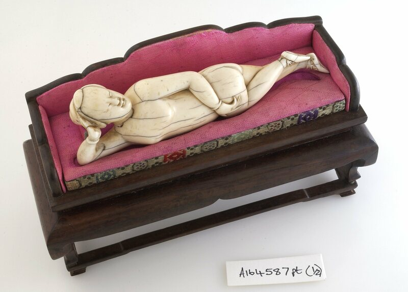 A diagnostic doll reclines on a miniature couch.