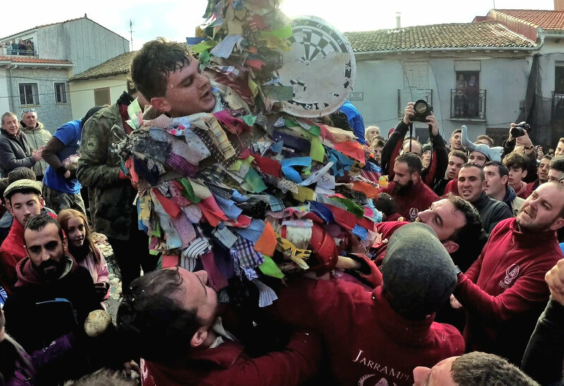 After surviving an hour, Adrián Moreno Serrano is lifted into the air in celebration.