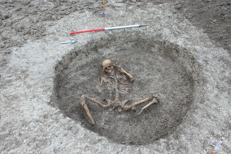 One woman was buried with her feet removed and placed by her side, and her arms behind her head.