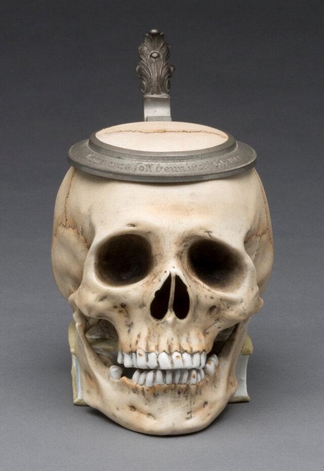 """Skull"" Stein, ca. 1900. Glazed hard paste porcelain, colored underglaze decoration, and pewter. Milwaukee Art Museum, Gift of the René von Schleinitz ..."