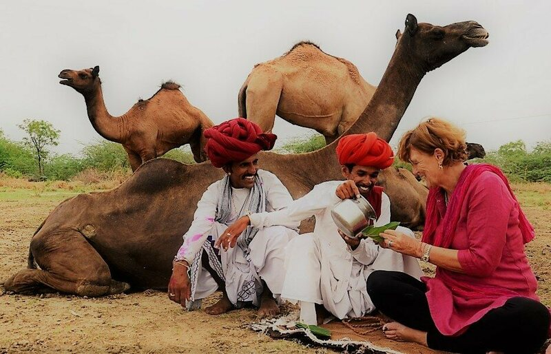 Dr. Ilse Köhler-Rollefson shares camel milk with two herders.