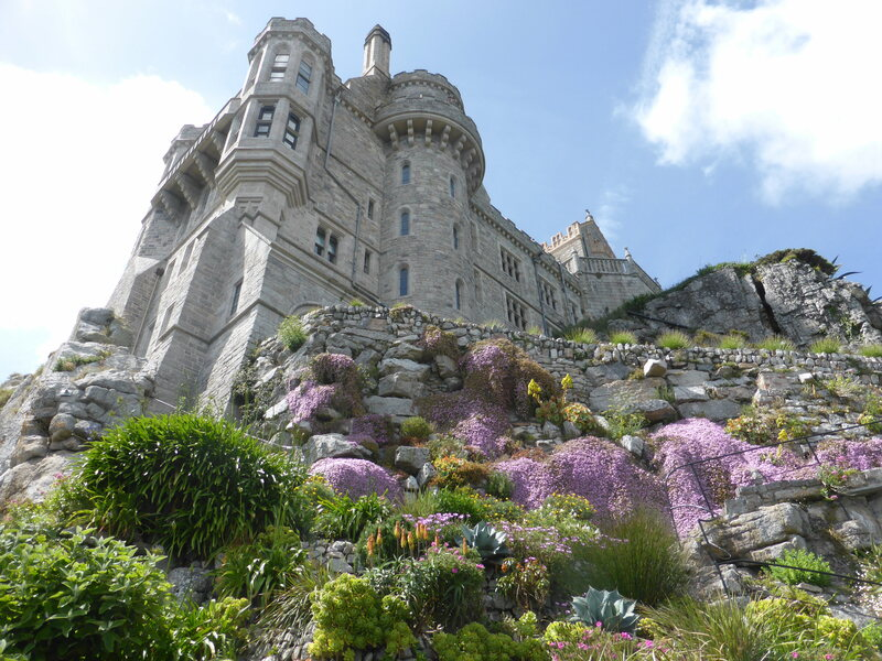 The castle on St. Michael's Mount towers over precarious gardens.