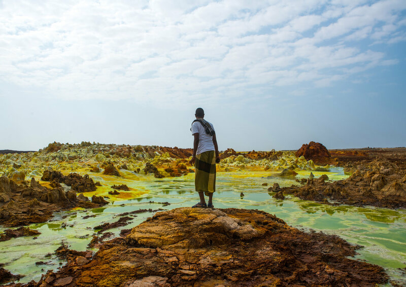 An Afar man looks over the volcanic landscape in Dallol.