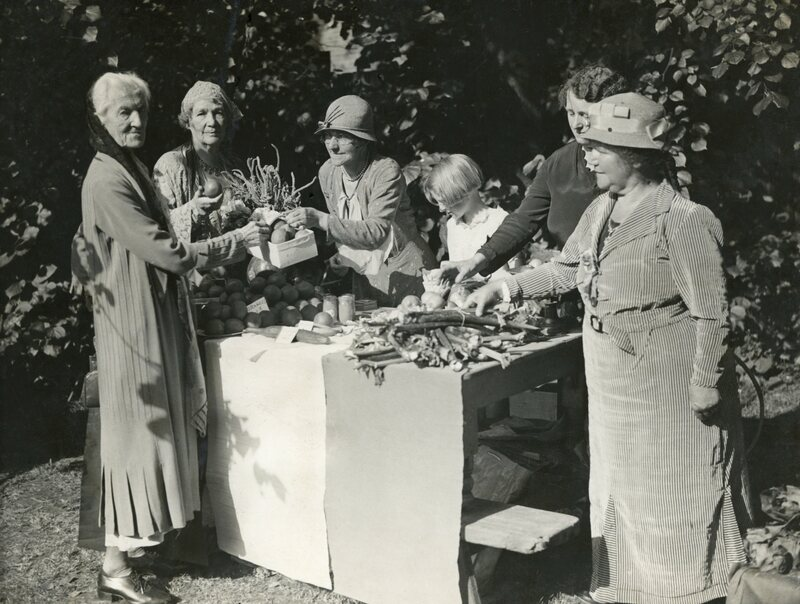 Suffragettes Charlotte Despard and Emmeline Pethick-Lawrence buy vegetables in the 1930s.