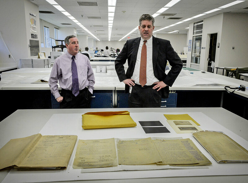 Mitch Yockelson (left), investigative archivist, and Jay Bosanko (right), COO of the National Archives, with recently rediscovered documents in 2016.